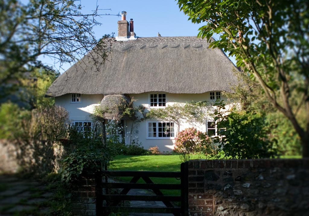 Heritage home with thatched roof, ideal application for secondary glazing