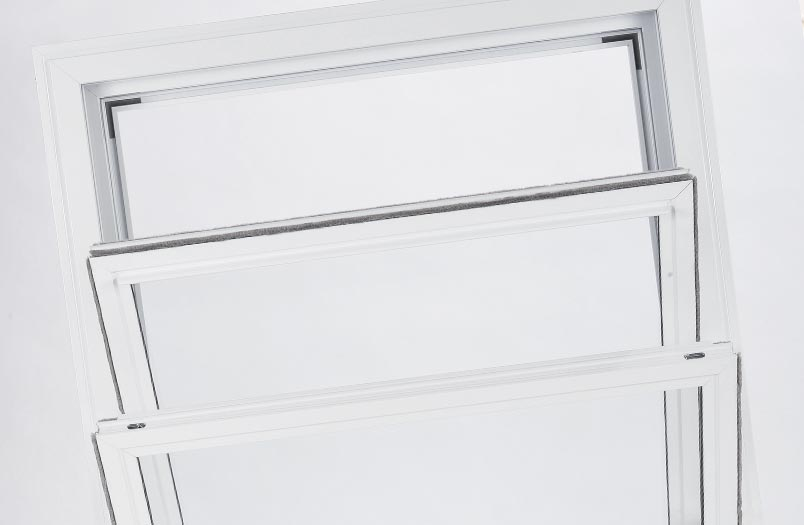 Secondary glazing unit in vertical sliding configuration